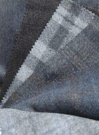Composition : laine 98% et polyester…